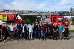 Gruppenfoto mit den Besuchern und den anwesenden Feuerwehrkräften der Ortsfeuerwehr Verden.