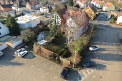 16.02.2016 - Die Grundstücke Lindhooper Straße 50, 48 sowie die Tankstelle (Nr. 46) vom Hof der Feuerwehr aus.