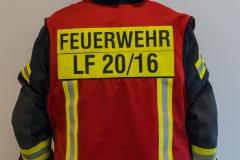 Mit einer roten Weste sind Gruppen- und Zugführer gekennzeichnet. Sie tragen die Verantwortung für ein oder mehrere Einsatzfahrzeuge sowie deren Besatzung.